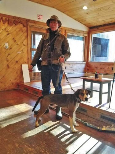 Trainer Kevin Brehan is shown with Zeke. Brehan helped rehabilitate Zeke and the beagle mix has finally found his forever home. (Source: Regional Animal Shelter website)