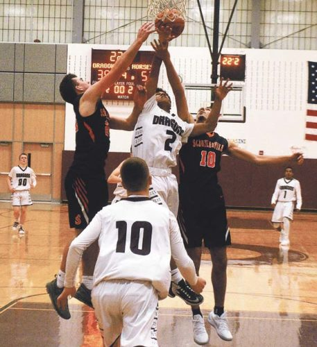 Gloversville's Jeremy Lombardoni looks on as Patrick Raldiris (2) battles Schuylerville's Paul Harshbarger left, and Nicholas Budesheim (10) for the offensive rebound during Foothills Council action Friday night at Gloversville High School. (The Leader-Herald/James A. Ellis)