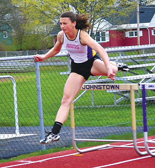 Amsterdam's Gabby Stanavich clears a hurdle on her way to victory in the 100-meter hurdles during an April 25, 2017 Foothills Council meet against Johnstown at Knox Field in Johnstown. (The Leader-Herald/Paul Wager)