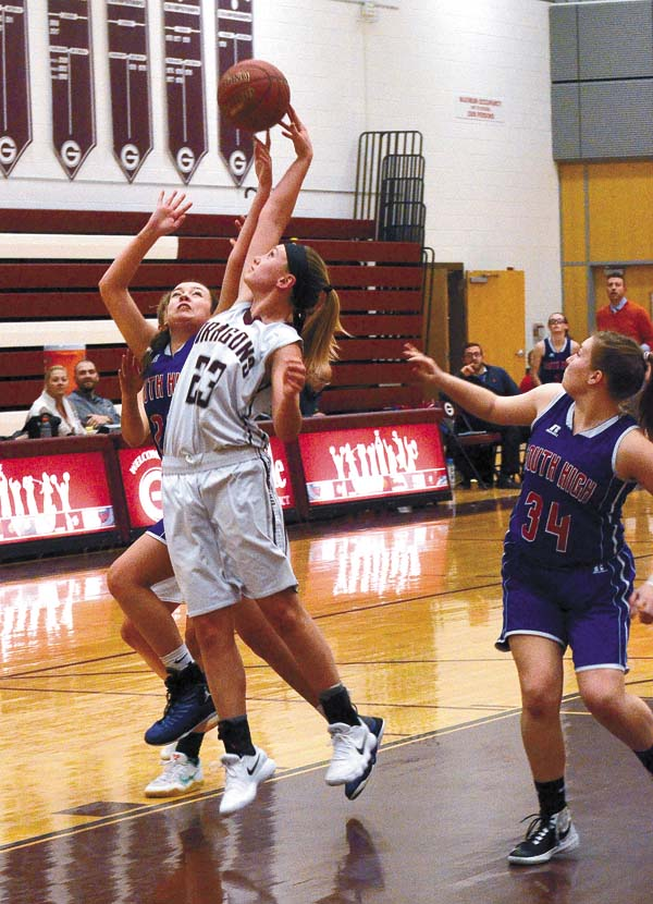 South Glens Falls' Maddy Ruby (34) looks on as Gloversville's Kendra Lavery (23) and South High's Jordan Palmer battle for a rebound during Foothills Council action Monday night at Gloversville High School. (The Leader-Herald/James A. Ellis)