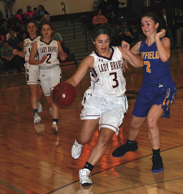 Fonda-Fultonville's Jillian Wilder (3) drives past Mayfield's Taryn LaFontaine during Tuesday's Western Athletic Conference game at Fonda-Fultonville High School. (The Leader-Herald/Paul Wager)