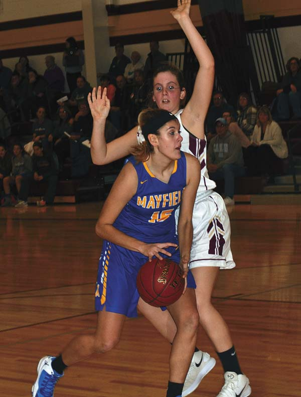 Fonda-Fultonville's Marilyn Whitcavitch, back, defends Mayfield's Katie LaGrange during Tuesday's Western Athletic Conference game at Fonda-Fultonville High School. (The Leader-Herald/Paul Wager)