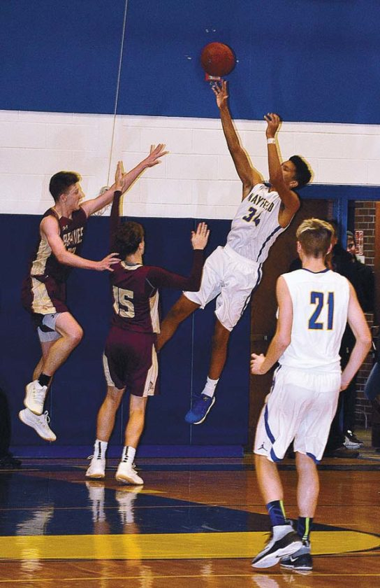 Mayfield's Trevon Gifford puts up a shot over Fonda-Fultonville's Nikolas Couture and John Mancini (15) during Western Athletic Conference action Wednesday at Mayfield High School. (The Leader-Herald/James A. Ellis)