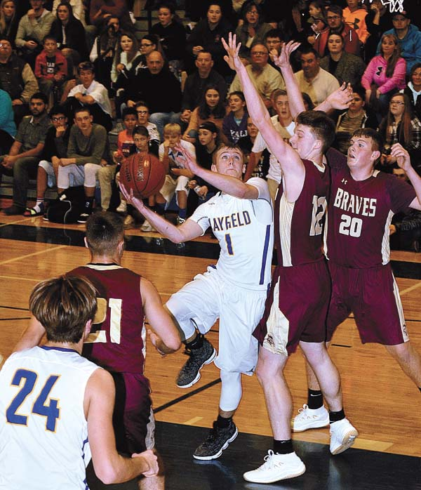 Mayfield's Kyle Dingman (1) looks to put up a shot over Fonda-Fultonville's Nikolas Couture (12) and Terrance Pierce (20) during Wednesday's Western Athletic Conference game at Mayfield High School. Looking on are the Braves' Massimo DiCaprio (21) and the Panthers' Walker Goodemote. (The Leader-Herald/james A. Ellis)