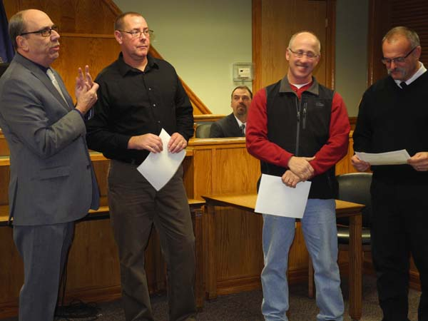 Three longtime city of Johnstown employees were honored for their service at a meeting of the Johnstown Common Council Monday night at City Hall. Johnstown Mayor Vern Jackson, left, presented the employees with certificates through the New York Conference of Mayors. Honored from left to right were: DPW working supervisors Wade Hohenforst and Michael Muzzi, both 35 years of service; and Johnstown Fire Chief Bruce Heberer, 30 years of service. Johnstown Senior Citizens Center Director Michelle Jones was also due to be honored, but couldn't attend. (The Leader-Herald/Michael Anich)