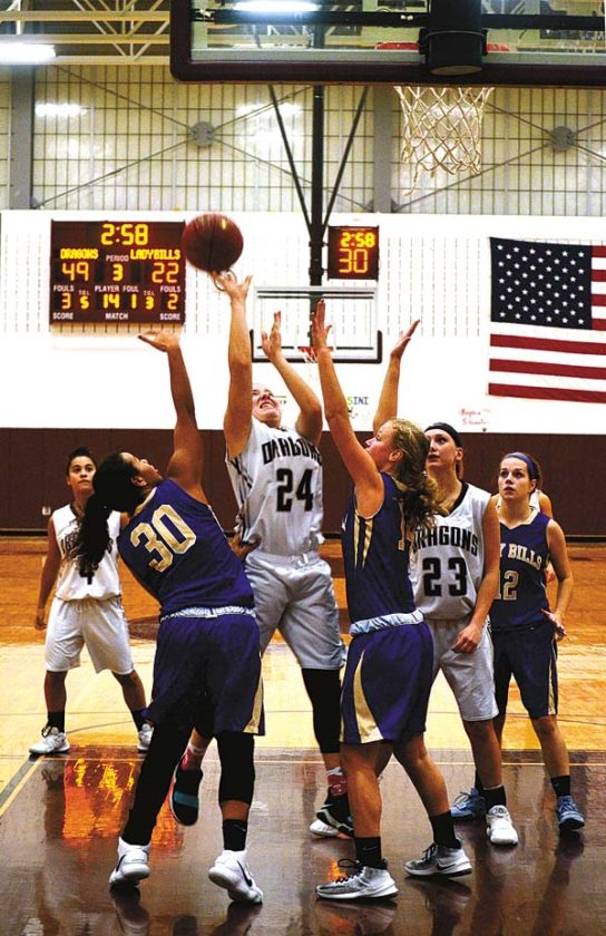 Gloversville's Alex Benfatti (24) puts back an offensive rebound while under pressure from Johnstown's Jaden Wilson (30) and Abby VandeWalker during Foothills Council action Thursday at Gloversville High School. (The Leader-Herald/James A. Ellis)
