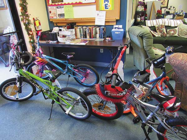 Bikes sit in the hallway of the Gloversville Senior Center during the Salvation Army of Fulton County Gift Drive collection awaiting their new owners. (The Leader-Herald/Kerry Minor)