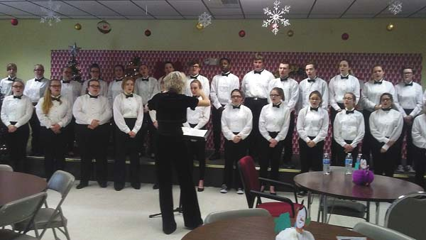 On Monday, the Gloversville High School Chorus, directed by Mrs. Kimberly Misceno, performed a lovely genre of Holiday Christmas Classics for the Gloversville 50/55 Plus Club members. The concert included a spirited sing- along with the High School's 27-member chorus and the senior club participants. Following their performance, each student received a gift bag full of holiday candy. (Photo submitted)
