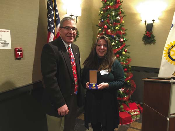 Dr. David Wills stands with Betsy Emery after she was honored with the Paul Harris Fellowship Award from the Glove Cities Rotary. (Photo submitted)