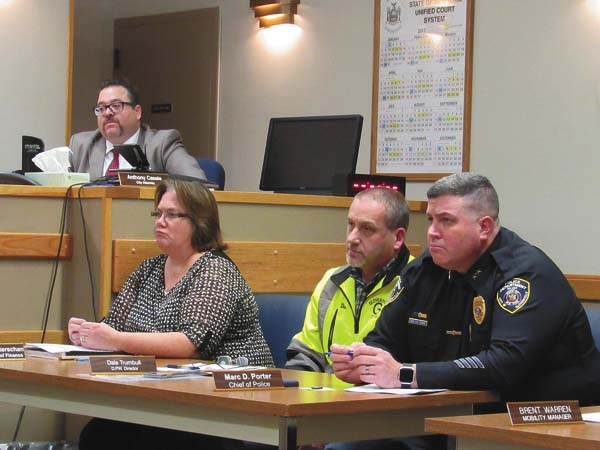 From left, City Attorney Anthony Casale; City Finance Commissioner Tammie Weiterschan; DPW Director Dale Trumbull and City Police Chief Marc Porter are shown during Tuesday's Common Council meeting. (The Leader-Herald/Kerry Minor)