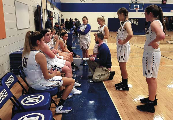 Mayfield coach Brian Moore sets up a play for the Lady Panthers during a time out in the first half of Wednesday's opening round of the Mayfield Holiday Tournament game against Broadalbin-Perth Wednesday at Mayfield High School. (The Leader-Herald/James A. Ellis)