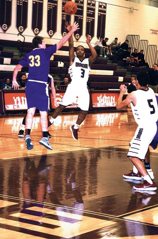 Voorheesville's Jack Murray (33) challenges Gloversville's Esean Brown (3) as he puts up a shot during an opening round game of the Coach K Festival Thursday at Gloversville High School. (The Leader-Herald/James A. Ellis)