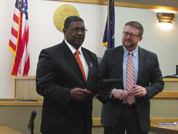 James Robinson accepts his proclamation from Mayor Dayton King during Tuesday's Common Council meeting. (The Leader-Herald/Kerry Minor)