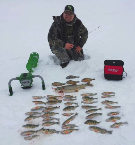 Pete with a mixed bag of perch, pumpkinseed, and lake trout caught jigging. (Photo courtesy of Capt. Stephen George)