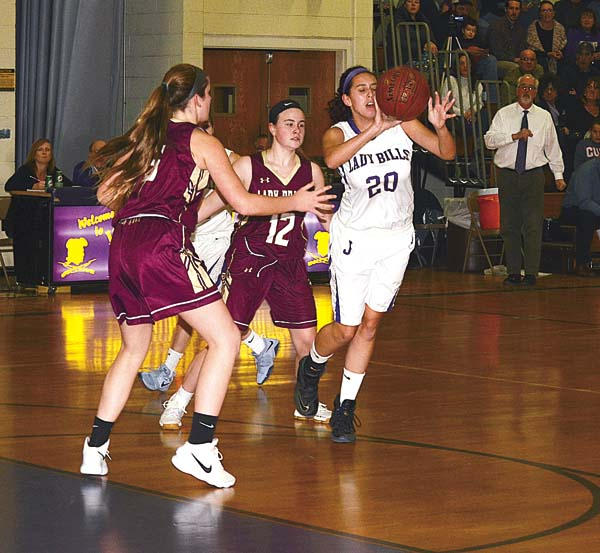 Johnstown's Allison Morey (20) passes the ball while under pressure from Fonda-Fultonville's Kaleigh Smith (12) and Marilyn Whitcavitch during Friday's non-league game at Warren Street Elementary School. (The Leader-Herald/James A. Ellis)