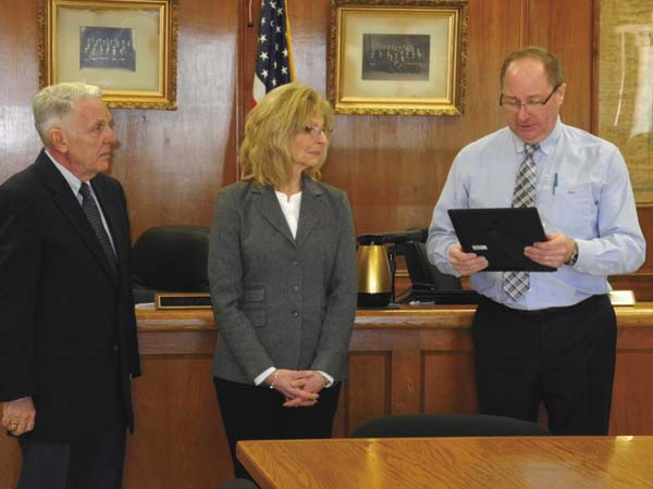 """Retiring Fulton County Clerk Ann Nickloy was honored with a resolution by the Fulton County Board of Supervisors Thursday at the County Office Building in Johnstown. At right, county Administrative Officer Jon Stead reads the resolution. Board Chairman Michael Kinowski, left, looks on. Nickloy distinguished herself as a """"friendly conduit"""" to the record-seeking public, the resolution stated. She served as deputy county clerk from 1998 to 2013, and as clerk from 2014 through the end of 2017. She told the board it was """"an honor"""" to serve as clerk. (The Leader-Herald/Michael Anich)"""