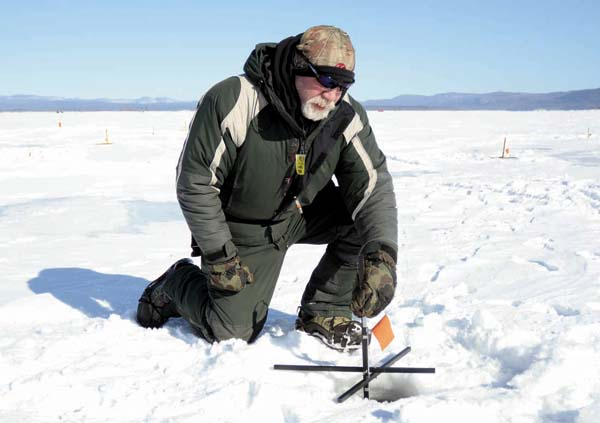 Jerry Simcik of the village of Florida, places a tip-up in a hole in the ice to catch a walleye during the 7th annual Walleye Challenge on the Great Sacandaga Lake on Jan 31, 2015. (The Leader-Herald file photo)
