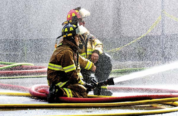 The Leader-Herald file photo A water mist is seen over firefighters during the fully-involved structure fire at Mancini Oil Co. in Fonda on July 18. (The Leader-Herald file photo)
