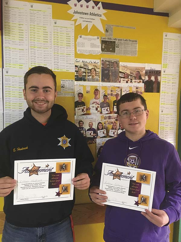 Athletic Director James Robare of the Greater Johnstown School District Athletic Department and Johnstown bowling coach David Hayward selected Ethan Hadcock, left, and Andrew Sitterly right, of the bowling team as the Student-Athletes of the Week. The award is chosen weekly and submitted by the Johnstown Athletic Department. (Photo submitted)