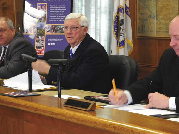 Northampton Supervisor James Groff, center, presides over his first Fulton County Board of Supervisors meeting as board chairman Tuesday at the County Office Building in Johnstown. At left is County Attorney Jason Brott and at right is Administrative Officer Jon Stead. (The Leader-Herald/Michael Anich)