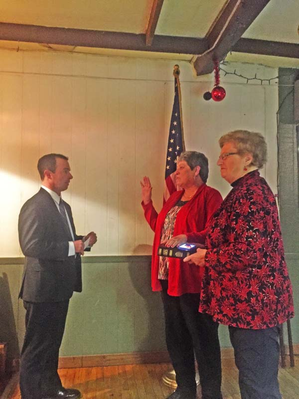 The newly elected Fulton county clerk, Linda Kollar, is sworn in by City Court Judge Brett Preston on Monday. Holding the Bible is her mother, Dorothy Putman. The newly appointed deputy county clerk is Leisa D'Amore. (Photo submitted)