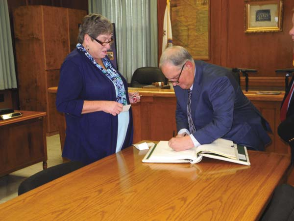 Gloversville 6th Ward Supervisor Warren Greene signs the Oath Book - witnessed by County Clerk Linda Kollar - prior to the Fulton County Board of Supervisors' organizational meeting Tuesday at the County Office Building in Johnstown. (The Leader-Herald/Michael Anich)