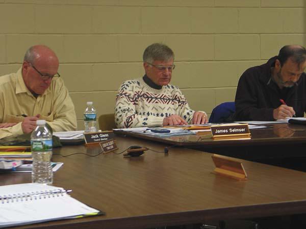 Town of Caroga Council member John Glenn, left, Supervisor James Selmser, Council member James Long, right, during the town of Caroga organizational meeting Wednesday. (The Leader Herald/Briana O'Hara)