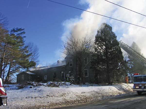 A fire at 5431 Route10, Palatine, fills house with smoke. (The Leader-Herald/Briana O'Hara)