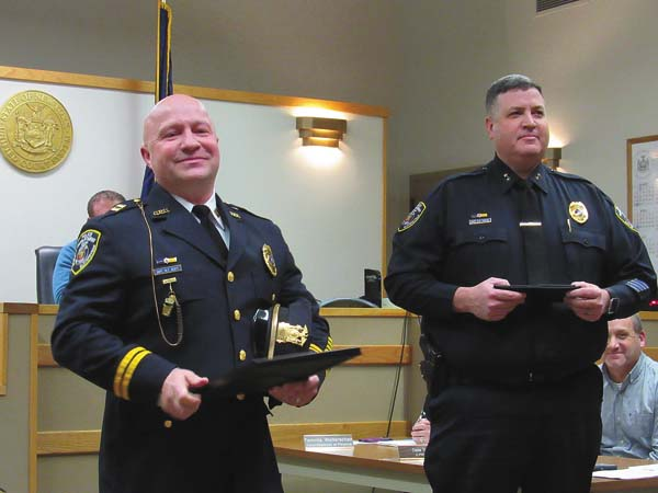 Gloversville Police Capt. Michael Scott, left, and Police Chief Marc Porter, right, stand before the audience during Tuesday's Common Council meeting. (The Leader-Herald/Kerry Minor )