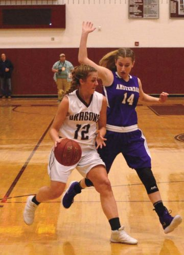 Gloversville's Harmony Philo (12) is tracked by Amsterdam's Lucia Liverio (14) as she brings the ball upcourt during Thursday's Foothills Council game at Gloversville High School. (The Leader-Herald/James A. Ellis)