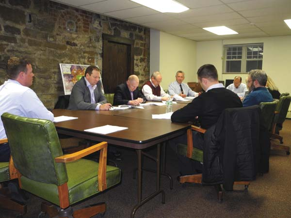 The Fulton County Industrial Development Agency board discusses raising fees at the group's annual meeting Tuesday at the Fort Johnstown Annex in Johnstown. (The Leader-Herald/Michael Anich)