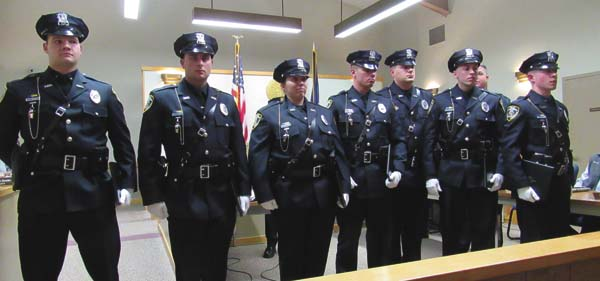 The seven new police officers who graduated the Zone 5 Police Academy on Jan. 5 are presented to the city during Tuesday's Common Council meeting. (The Leader-Herald/Kerry Minor)