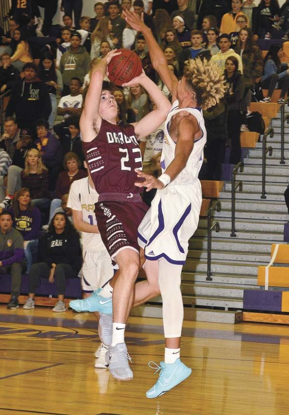 Amsterdam's Willie Brown goes for the block as Gloversville's Joey Rowback (23) puts up a shot during Friday's Foothills Council game at Amsterdam High School. (The Leader-Herald/James A. Ellis)