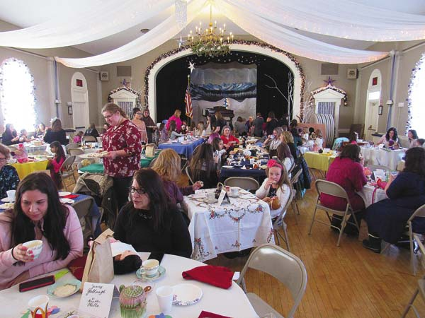 About 110 parents and daughters participate in the My Favorite Doll Tea on Saturday afternoon at the Century Club in Amsterdam. (The Leader-Herald/Eric Retzlaff)