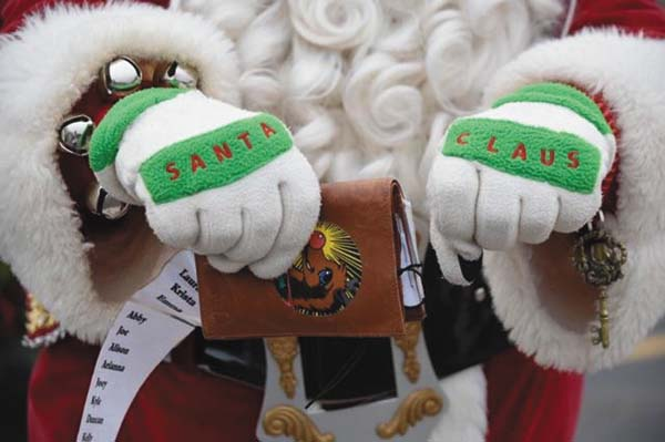 Santa Mike shows off some of the things he uses as Santa Claus. The club he is forming will also include Mrs. Clauses and elves. Below is a photo of Santa Mike. (Photo submitted)