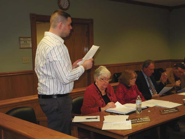 Johnstown 1st Water Councilman Bradley Hayner, standing, reads a resolution approving a city water agreement with Fulton County at the Johnstown Common Council meeting Tuesday night at City Hall. (The Leader-Herald/Michael Anich)