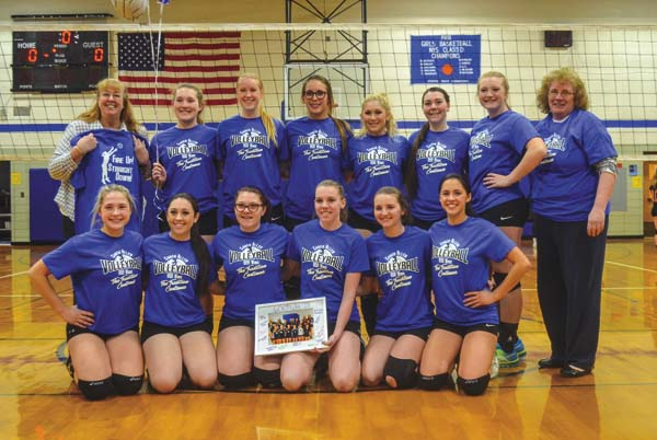 Dolgeville coach Barb Allen, back row, left, poses with her team after picking up her 600th career coaching victory Wednesday at Dolgeville High School. (The Leader-Herald/James A. Ellis)
