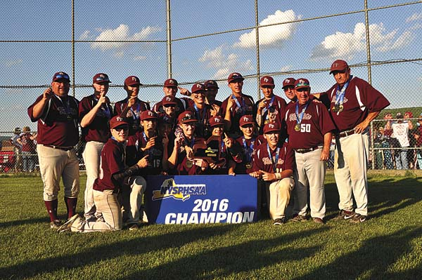 Fort Plain baseball coach Craig Phillips, far right, poses with his team after winning the state Class D championship game in 2016. Phillips was named a 2017 National Coach of the Year by the National Federation of State High School Associations Coaches Association last week. (The Leader-Herald/James A. Ellis)