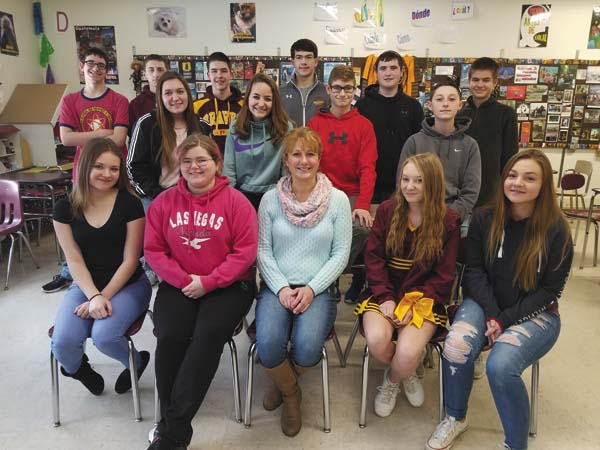 The students at Fonda-Fultonville Central School District in Sherri Lott's Spanish classes conducted their annual fundraiser through December for local animal shelters. Shown, from left, in front row, are Jocelyn Miller, Sydney Jones, Lott, Faith Brisbane and Kailey Hughes;  second row, Emma Agnes, Adriana Butler, Gabe Mormile and Joseph Battisti; and third row, Sawyer York, Jackson Thompson, Gus Snow, Jacob Belfance, Jake Bowles and Matthew Buanno. (Photo submitted)
