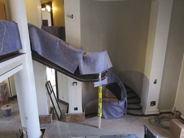 The spiral staircases at the Gloversville Public Library are shown covered to protect them from any construction debris. (The Leader-Herald/Kerry Minor)