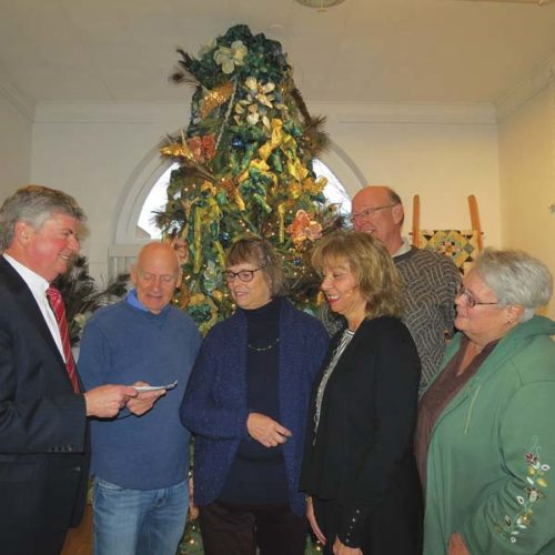 Photo submitted Ron Zimmerman, left, representing the Schine Gallery, presents a check for $2,376 to the Glove Performing Arts Center board members from left, Richard Samrov, Patricia Butkus, Sharon P. Poling, Stanley Bojarski and JoAnn Samrov. The funds were raised at the Schine on The Holidays~2017 exhibit held recently at the Schine Gallery, 40 N. Main St.  (Photo submitted)