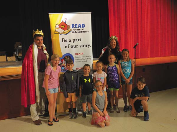 Fonda-Fultonville  Elementary and  Middle Schools launched the Read for Ronald McDonald House program at an assembly in the fall. Since then, students have raised $3,000 for the organization while becoming better readers. From the left are middle school Principal David Zadoorian,Alexis Neri, Aidan Sheridan,Lucas Polsinelli,Kaylee Flynn,Maggie LaPlant, elementary school Principal Darcy Williams, Grace Furnare and Tucker Borst.  Kneeling in front isZoey Paton. (Photo submitted)