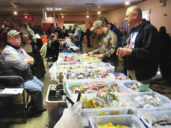 Ed Drake of D&D Baits and Supplies, left, talks with Keith Timont of Charlton at the 13th annual Adirondack Outdoorsman Show Saturday at the Moose Lodge in Johnstown. (The Leader-Herald/Eric Retzlaff)