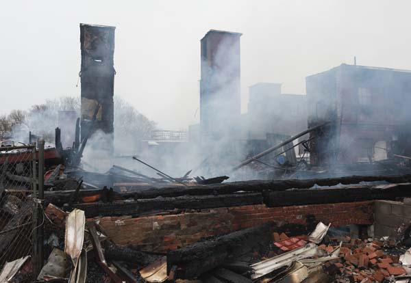 The charred remains of the former Tradition and JBF leather tannery complex are pictured Sunday. (Photo contributed by Warren Greene)