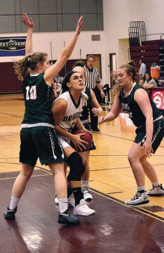 Hudson Falls' Danielle Kitchner (10) and Jana DePalo, right close in on Gloversville's Kerri Hauser as she eyes the basket during Monday Foothills Council game at Gloversville High School. (The Leader-Herald/James A. Ellis)