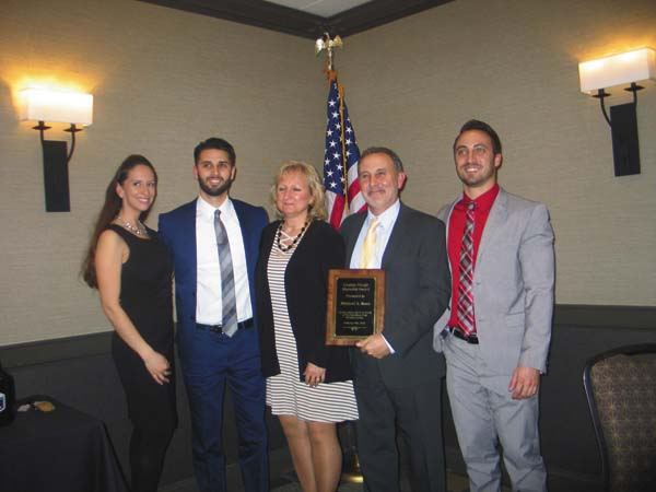 Winner of the Hough Memorial Award, Michael Rose, second from right, surrounded by family starting from the left, Brittany Richards, Chris Rose, Suzanne Rose, Michael Rose and Matthew Rose. (The Leader-Herald/Briana O'Hara)