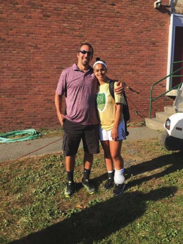 Natasha Simon, right, poses with Gloversville girls varsity soccer coach Mike Hallenbeck following her senior game last fall. (Photo submitted)