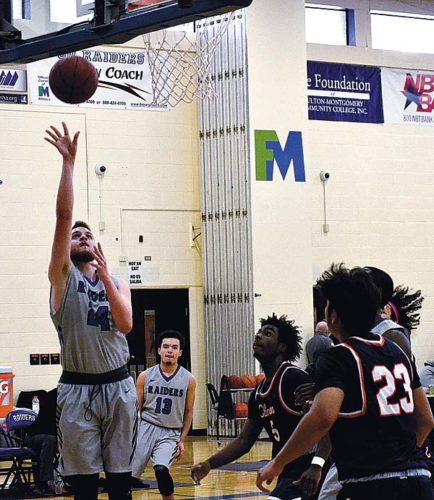 Fulton-Montgomery Communtiy College's Austin Jones (24) goes up for a shot as Clinton Community College's DaJuan Williamson (5) looks on during Sunday's Mountain Valley Conference game. (The Leader-Herald/Paul Wager)