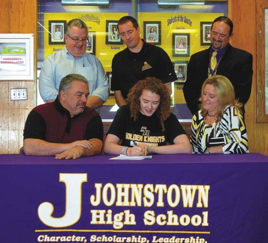 Johnstown senior Emily Miles, center, signs her National Letter of Intent to swim for The College of Saint Rose next fall on Feb. 13. Looking on are her father, Richard and mother Melissa along with club coach Mike Schanthel, back row, left, College of Saint Rose swim coach Keith Murray and Johnstown Director of Athletics James Robare. (The Leader-Herald/James A. Ellis)