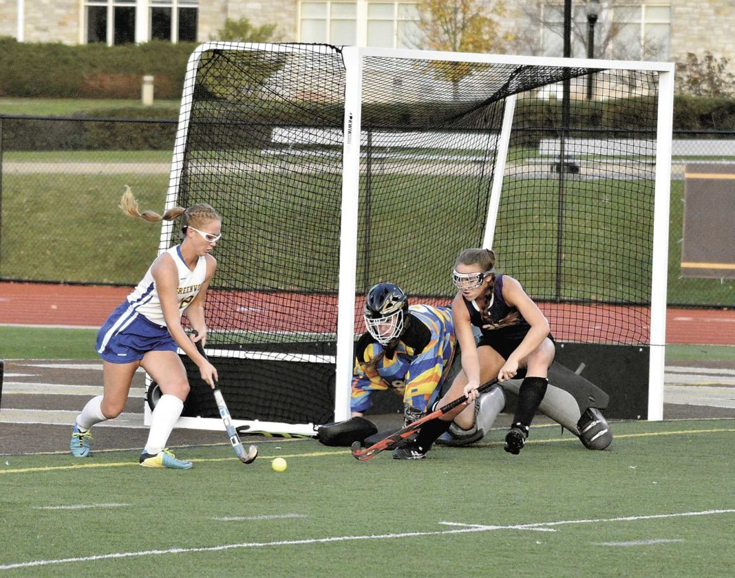 Sentinel photo by JEFF FISHBEIN Greenwood's Maddy Pyle, left, tries to get the ball past Boiling Springs' goalie Megan Lay and defender Kylee Dale in  Wednesday's District 3 Class A field hockey semifinal in Hershey.